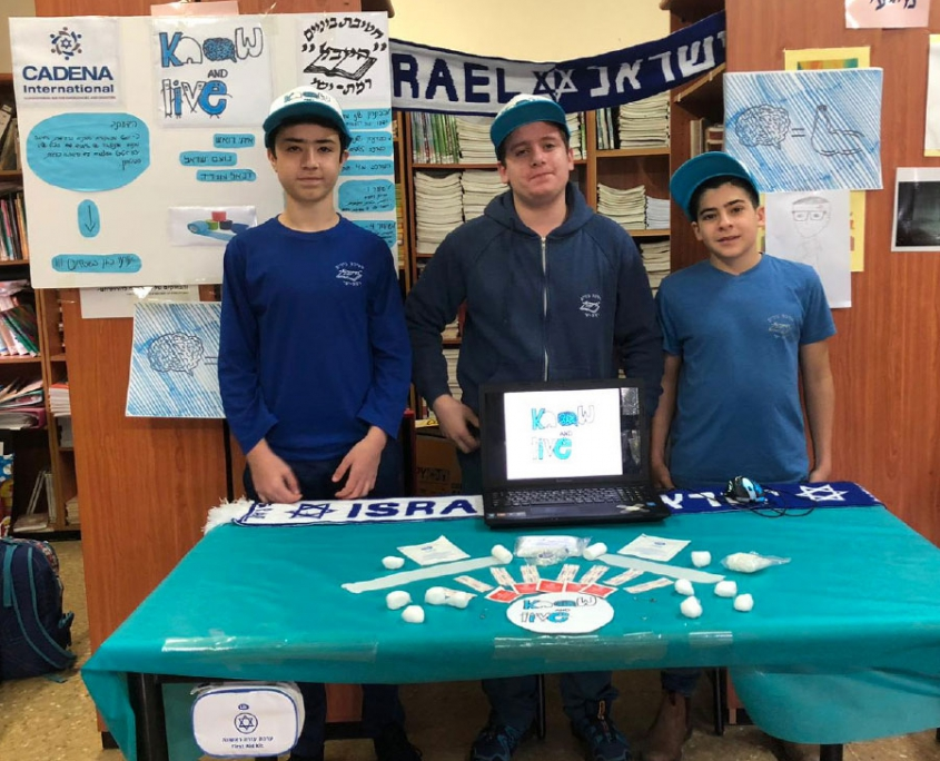 Three kids presenting a project from CADENA Israel