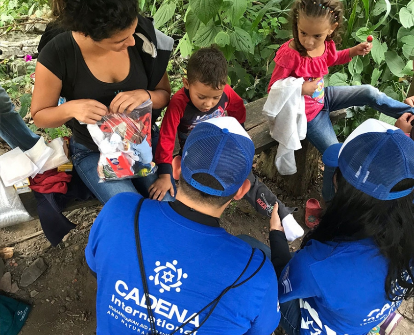 Volunteers from CADENA USA helping a family